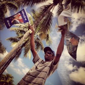 Man sells flags outside Bank United Center in Miami where President Obama was speaking on October 11, 2012.