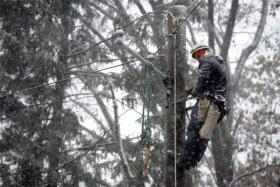 In South Orange, N.J., FPL Line Specialist Jeff Wasson of Sarasota repairs downed power lines in a snowstorm.