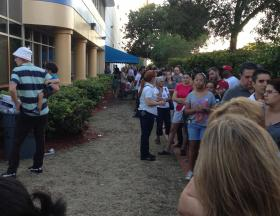 People in Doral wait in a long line to vote in an impromptu voting location Sunday.