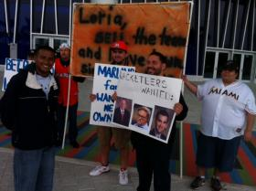 A small group of Marlins fans demonstrate in front of the team's new Miami ballpark. They're upset at their latest dismantling, and want owner Jeffrey Loria to sell the Marlins.