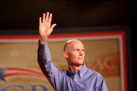 Gov. Scott says he will implement the Affordable Care Act in Florida.