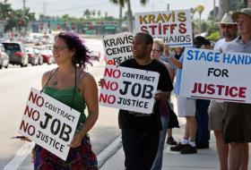 STRIKERS: Union stagehands picket the Kravis Center. Four performances of