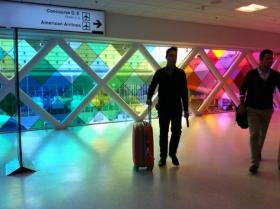 Travelers arrive at MIA to the sounds and sights of Christopher Janney's Harmonic Convergence.
