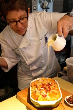 Pastry chef Hedy Goldsmith prepares bread pudding at Michael's Genuine Food & Drink.