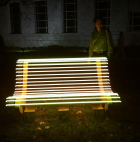 Is This Art? Neon bench is part of a three-bench installation called 'Street Lamp' by Iván Navarro and Courtney Smith. One of the benches was damaged when an Art Basel visitor sat on it.