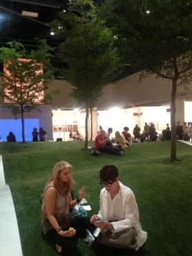 Chris Reilly and Anne Harmson enjoy their lunch in a tiny artificial park within Art Basel.