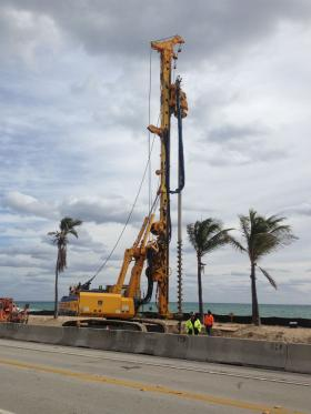 Workers begin drilling along a section of State Road A1A in Fort Lauderdale.