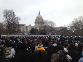 Thousands of people wait to attend Monday's inauguration ceremony, where Rev. Luis León delivered the benediction.