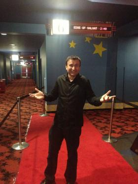 L.A.-based indie filmmaker Luciano Saber awaits preview audiences inside Muvico Pompano.