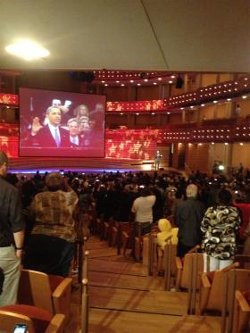 Audience inside Adrienne Arsht Center's Knight Concert Hall watching simulcast of Monday's inauguration
