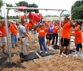 Volunteers build a playground at a charter school in Tampa.