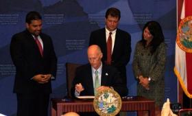 BECOMING LAW: Gov. Rick Scott signed the bill requiring employee contributions to the pension plan on June 23, 2011.  The Florida Supreme Court upheld it Thursday.