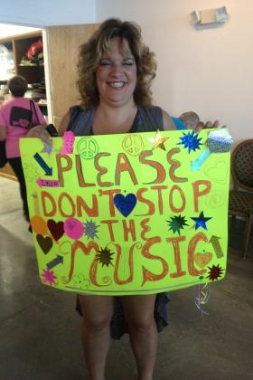 Michelle Lynn of West Palm Beach joins a group rallying in support of Arts Garage.