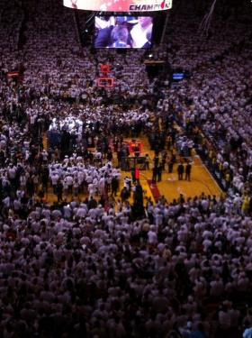 The celebration begins inside the American Airlines Arena after the Heat beats the Oklahoma City Thunder in five games to claim NBA title.