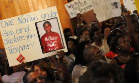 Civil rights leaders and residents of the city of Sanford, FL attend a town hall meeting to discuss the death of a 17-year-old unarmed black teen Trayvon Martin.