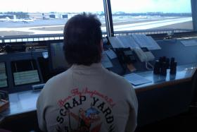 Air traffic controller Ron Wooldridge looks out over the runway of Boca Raton Airport.