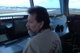 Air traffic controller Ron Wooldridge guides in flights at Boca Raton Airport.  Boca is one of two small South Florida airports losing their control towers to sequestration cuts.