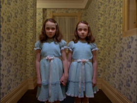 This haunting scene is from The Shining, a classic film by Stanley Kubrick.