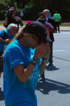 Lauren Book, flanked by media near the Capitol, completes her fourth walk across Florida.
