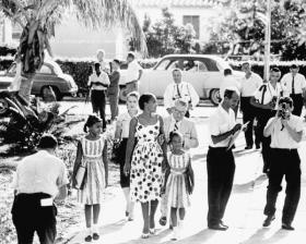 A woman escorts her two daughters to Orchid Villa School in Miami during desegregation.
