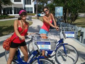 Tourists from Colombia enjoying a bike share on Fort Lauderdale beach.