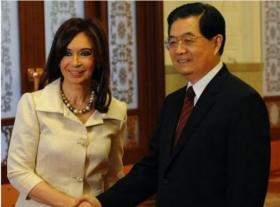 Argentinian President Cristina Kirchner and former Chinese President Hu Jintao shake hands during the signing of a major trade agreement between both countries in 2010.