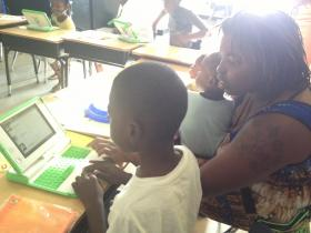 First grader Adam Redding and his mother Lyndra Forbes research the parts of a plant on a classroom computer.