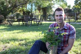 Chad Scott on the property of the Flagler Village Community Garden in downtown Fort Lauderdale.