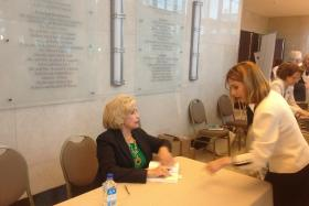 Equal-pay advocate Lilly Ledbetter signs her new book for a fan at the Kravis Center in West Palm Beach.