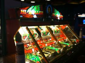 Popular gaming chain Dave & Busters features slot machines where players insert enough tokens to claim prizes.