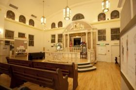 Housed in a former synagogue, the Jewish Museum of Florida-FIU features the original 1936 stained glass windows and marble platform, or bimah, from which sacred scripture was read.