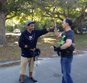 High fives for Robert Aguilar and his therapist Isaac Farin after a longboard flow session.