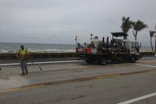 Work crews on a stretch of A1A along Fort Lauderdale Beach put the finishing touches on a five-month long road repair.