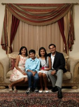 Gitika and Sapan Bafna, pictured with their two children, are working to expand religious understanding in South Florida.