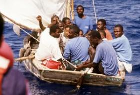 Many Haitian refugees took to rickety boats to escape their military regime's violence.