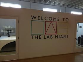 A warm greeting on the wall of office space inside The Lab Miami.
