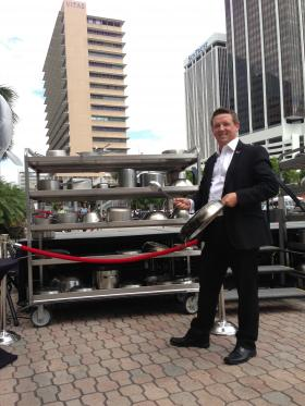 "Dapper Pan: InterContinental Miami's general manager, Robert Hill, whacks a 20"" frying pan with a soup ladle."