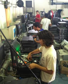 Students at Park Vista Community High School refurbish computers for donation.