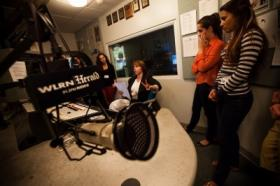 FIU students work with WLRN staff to produce their own radio reports.