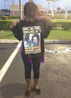 Ashley Aristide holds up a t-shirt she had made in honor of classmate Trayvon Martin. Martin was shot and killed Feb. 26 by a volunteer neighborhood watchman in an Orlando-area neighborhood.