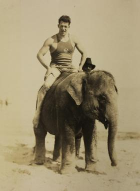 Morman Ross rides an elephant on Miami Beach in 1922. Coral Gables wanted to discourage this circus-like atmosphere.