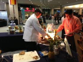 The Columbia Restaurant handed out sandwich samples at the Tampa airport as part of a promotion of Cuban flights.