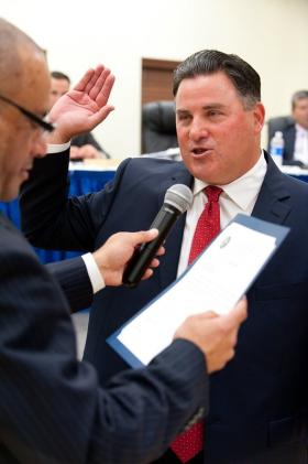 Miami Lakes Vice Mayor Ceasar Mestre (left) administers the oath of office to Mayor Michael Pizzi during a swearing in ceremony at Royal Oaks Community Center in Miami Lakes on Tuesday, Nov. 27, 2012.