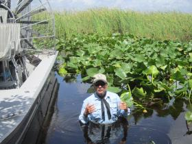 Commissioner Ron Bergeron of the Florida Fish and Wildlife Conservation Commission stands in almost four feet of water in the Florida Everglades to show the hazardous high water levels.