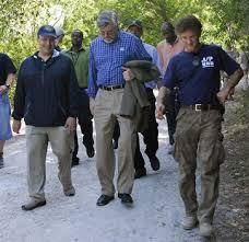 Frank Mora (left) then Deputy Assistant Secretary of Defense, walking through quake-ravaged Port-au-Prince with then Deputy Assistant Secretary of Defense Jim Schear and actor/activist Sean Penn in April 2010.
