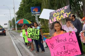 Demonstrators during last Saturday's library rally near the Concord branch.