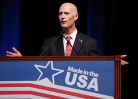 Florida Gov. Rick Scott speaks during a Walmart U.S. Manufacturing Summit at the Orange County Convention Center in Orlando, Florida on Thursday, August 22, 2013.