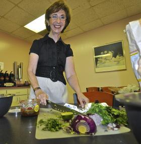 Linda Gassenheimer prepares for the guacamole taste test.