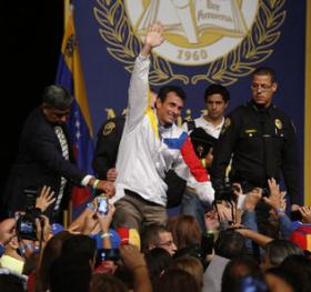 Henrique Capriles Radonsky waves to supporters gathered at the James L. Knight Center following a speech in which he urged Venezuelans living in the United States to continue working for a Democratic change in Venezuela.