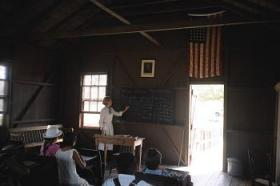 Students spend a day learning about Florida's history at the Little Red Schoolhouse.